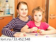 Купить «Two adorable little happy sisters are playing in their room.», фото № 33452548, снято 6 февраля 2020 г. (c) Акиньшин Владимир / Фотобанк Лори