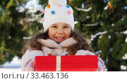 Купить «happy girl with christmas gift in winter park», видеоролик № 33463136, снято 9 марта 2020 г. (c) Syda Productions / Фотобанк Лори