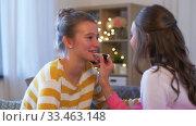 Купить «happy teenage girls doing make up at home», видеоролик № 33463148, снято 6 марта 2020 г. (c) Syda Productions / Фотобанк Лори