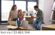 Купить «happy family with child moving to new home», видеоролик № 33463164, снято 22 марта 2020 г. (c) Syda Productions / Фотобанк Лори