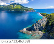 Купить «Aerial view of Scotts Head, Dominica, West Indies. On left side is Caribbean Sea, on right side, Atlantic Ocean. November 2019. Drone photo, stitched panorama.», фото № 33463388, снято 15 июля 2020 г. (c) Nature Picture Library / Фотобанк Лори