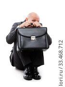 Купить «Unhappy scared or terrified businessman in depression hand holding briefcase», фото № 33468712, снято 7 августа 2019 г. (c) Илья Андриянов / Фотобанк Лори