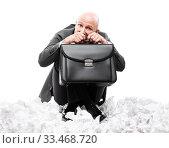 Купить «Unhappy scared or terrified businessman in depression hand holding briefcase», фото № 33468720, снято 7 августа 2019 г. (c) Илья Андриянов / Фотобанк Лори