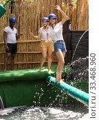 Купить «Youth in the amusement park trying to pass through an obstacle course», фото № 33468960, снято 3 апреля 2020 г. (c) Яков Филимонов / Фотобанк Лори