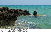 Купить «The clear water and surf waves near the rocky shore of the Ayia Thekla beach. Cyprus», видеоролик № 33469532, снято 30 марта 2020 г. (c) Serg Zastavkin / Фотобанк Лори