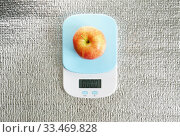 Red glossy apple on scales with GOOD message, on silver background. Template healthy food with eco fruit. Closeup. Стоковое фото, фотограф Dmitry Domashenko / Фотобанк Лори