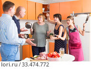 Купить «Women opposing men in kitchen», фото № 33474772, снято 17 августа 2019 г. (c) Яков Филимонов / Фотобанк Лори