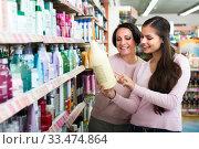 Купить «Women selecting hair care in store», фото № 33474864, снято 5 июня 2020 г. (c) Яков Филимонов / Фотобанк Лори
