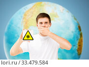 scared man with coronavirus sign over earth planet. Стоковое фото, фотограф Syda Productions / Фотобанк Лори