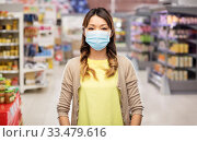 Купить «asian young woman in protective medical mask», фото № 33479616, снято 11 мая 2019 г. (c) Syda Productions / Фотобанк Лори