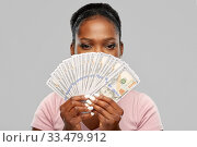 Купить «african american woman hiding behind dollar money», фото № 33479912, снято 26 января 2020 г. (c) Syda Productions / Фотобанк Лори