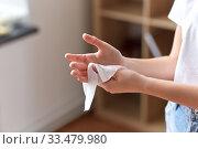 Купить «woman cleaning hands with antiseptic wet wipe», фото № 33479980, снято 13 марта 2020 г. (c) Syda Productions / Фотобанк Лори