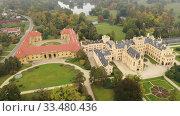 Купить «Aerial view on the medieval castle Lednice. South Moravian region. Czech Republic», видеоролик № 33480436, снято 16 октября 2019 г. (c) Яков Филимонов / Фотобанк Лори
