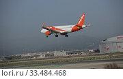 Купить «EasyJet Europe Airbus A319-111 with OE-IJF registration flying on cloudy day, approaching landing in El Prat Airport», видеоролик № 33484468, снято 24 января 2020 г. (c) Яков Филимонов / Фотобанк Лори