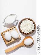 Купить «Food is a source of calcium, magnesium, protein, fats, carbohydrates, balanced diet. Dairy products on the table: cottage cheese, sour cream, milk, chicken egg, contain casein, albumin, globulin, free lactose», фото № 33484696, снято 14 декабря 2019 г. (c) Светлана Евграфова / Фотобанк Лори