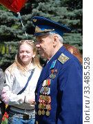 Купить «Ветеран Великой Отечественной войны во время праздника Победы 9 мая на Поклонной горе в Москве», эксклюзивное фото № 33485528, снято 9 мая 2010 г. (c) lana1501 / Фотобанк Лори