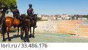 Купить «mounted police oversees the order on the promenade of the city beach of Santander in summer. Cantabria. Spain», фото № 33486176, снято 21 июля 2019 г. (c) Татьяна Яцевич / Фотобанк Лори