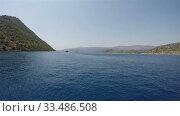 Купить «sea walk on a clear sea in a mountainous area», видеоролик № 33486508, снято 26 ноября 2019 г. (c) Aleksandr Sulimov / Фотобанк Лори