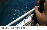 Купить «the girl holds on to the railing standing on the deck of the yacht and admires the sea», видеоролик № 33486648, снято 26 ноября 2019 г. (c) Aleksandr Sulimov / Фотобанк Лори