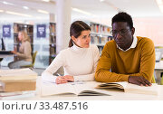Portrait of couple of adult students studying together in public library. Стоковое фото, фотограф Яков Филимонов / Фотобанк Лори