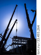 Купить «Cranes at a construction site at Strijp-S, Eindhoven, The Netherlands, Europe.», фото № 33493264, снято 23 марта 2020 г. (c) age Fotostock / Фотобанк Лори