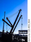 Купить «Cranes at a construction site at Strijp-S, Eindhoven, The Netherlands, Europe.», фото № 33493364, снято 23 марта 2020 г. (c) age Fotostock / Фотобанк Лори