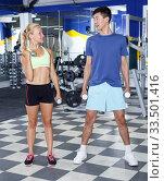 Купить «Couple during weightlifting workout», фото № 33501416, снято 16 июля 2018 г. (c) Яков Филимонов / Фотобанк Лори