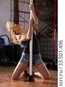 Young woman in denim shorts practicing pole dancing. Стоковое фото, фотограф Яков Филимонов / Фотобанк Лори