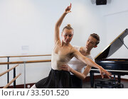 Ballet partners dancing gracefully together in the ballet studio. Стоковое фото, фотограф Яков Филимонов / Фотобанк Лори