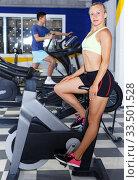 Купить «athletic woman working out on exercise bike», фото № 33501528, снято 16 июля 2018 г. (c) Яков Филимонов / Фотобанк Лори