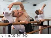 Купить «Teenager and women practicing at the ballet barre», фото № 33501540, снято 26 апреля 2019 г. (c) Яков Филимонов / Фотобанк Лори