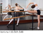 Купить «Positive teenager practicing at the ballet barre», фото № 33501548, снято 26 апреля 2019 г. (c) Яков Филимонов / Фотобанк Лори