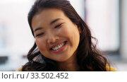 Купить «portrait of happy smiling asian young woman», видеоролик № 33502452, снято 26 марта 2020 г. (c) Syda Productions / Фотобанк Лори