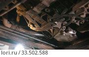 Купить «Auto repair shop - parts of the car from below - man wipes out the detail from the dirt», видеоролик № 33502588, снято 8 апреля 2020 г. (c) Константин Шишкин / Фотобанк Лори