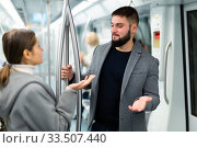 Portrait of playful positive people making acquaintance in public transport. Стоковое фото, фотограф Яков Филимонов / Фотобанк Лори