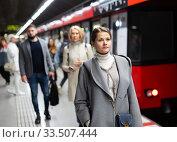 Купить «Female waiting for train on subway platform», фото № 33507444, снято 11 июля 2020 г. (c) Яков Филимонов / Фотобанк Лори