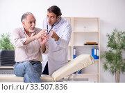 Купить «Young male doctor and old patient in antismoking concept», фото № 33507836, снято 9 сентября 2019 г. (c) Elnur / Фотобанк Лори