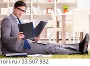 Businessman working on the floor at home. Стоковое фото, фотограф Elnur / Фотобанк Лори
