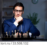Купить «Businessman playing chess in strategy concept», фото № 33508132, снято 9 октября 2017 г. (c) Elnur / Фотобанк Лори