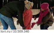 Купить «happy family at outdoor skating rink in winter», видеоролик № 33509340, снято 22 марта 2020 г. (c) Syda Productions / Фотобанк Лори
