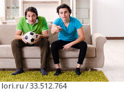Купить «Friends watching football at home», фото № 33512764, снято 5 февраля 2019 г. (c) Elnur / Фотобанк Лори