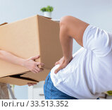 Young family unpacking at new house with boxes. Стоковое фото, фотограф Elnur / Фотобанк Лори