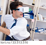Employee watching movie on vr virtual reality glasses. Стоковое фото, фотограф Elnur / Фотобанк Лори