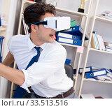Купить «Employee watching movie on vr virtual reality glasses», фото № 33513516, снято 3 августа 2017 г. (c) Elnur / Фотобанк Лори