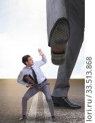 Купить «Bad angry boss kicking employee in business concept», фото № 33513868, снято 10 июля 2020 г. (c) Elnur / Фотобанк Лори