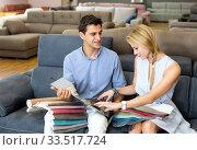 Купить «Couple are choosing of colors for new sofa», фото № 33517724, снято 19 июня 2017 г. (c) Яков Филимонов / Фотобанк Лори