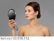 Купить «beautiful young woman looking to mirror», фото № 33518112, снято 30 ноября 2019 г. (c) Syda Productions / Фотобанк Лори
