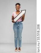 Купить «african woman with arrow showing north east», фото № 33518208, снято 26 января 2020 г. (c) Syda Productions / Фотобанк Лори