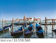 Купить «View from San Marco square of the cathedral of San Giorgio Maggiore, the Venetian lagoon and gondolas. Venice, Italy», фото № 33518560, снято 14 апреля 2017 г. (c) Наталья Волкова / Фотобанк Лори
