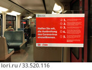Berlin, Germany, sticker with information on the containment of the corona virus in a suburban railway car. Редакционное фото, агентство Caro Photoagency / Фотобанк Лори